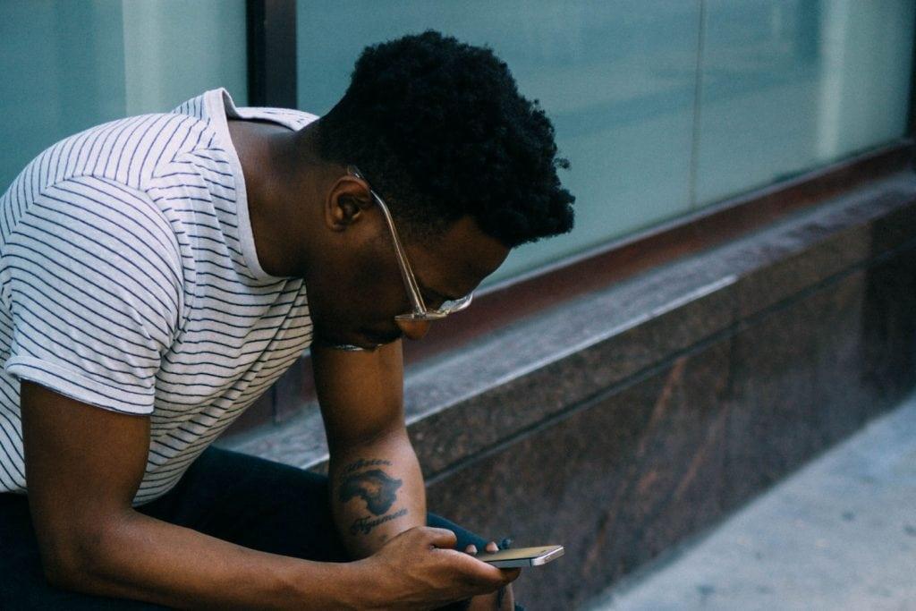 Guy looking at smart phone